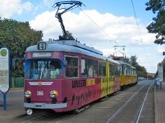 Triebwagen 396 zusammen mit dem Traditionszug 56-82-101 an der Haltestelle Wagenhalle. (12. September 2004)